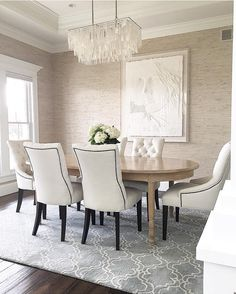 @carolineondesign Neutral dining room with textured Seabrook grasscloth wall covering. West Elm Capiz Chandelier. Pottery Barn Scroll Tile Rug. Frank Gallo original art.