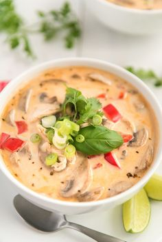 This Chicken Coconut Soup, also known as Tom Kha Gai, is an incredibly aromatic and flavorful Thai dish made with chicken, mushrooms, peppers, in a creamy coconut broth. via @sugarandsoulco