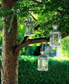 ikea tea light lanterns on outdoor trees