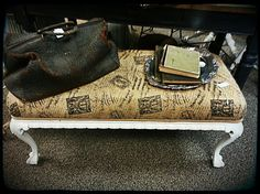burlap covered bench, antique doctor's bag, silverplate mirror tray, antique books
