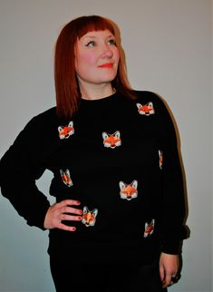 Welcome to Handmaiden. 'Foxes' is from my new range of handmade embroidered sweatshirt. now available in limited numbers to buy at www.handmaidenlondon.com.