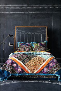 colorful bedding. chalkboard walls. a stunning bedroom.