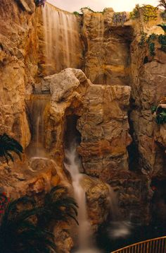 55' indoor #waterfall created @ clubregent #casino by #Rockscapes of #Canada. This beauty roars when put to full blast! Made from sweat, blood, and #cement! All #artificial #rock