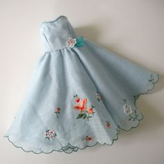 A doll's dress made from a hankerchief.
