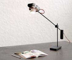 Y Studio repurposed the bodies of old and broken film cameras as lamp shades for minimalist desk lamps. Reborn 001 is based on a folding camera, Reborn 003 is based on a flash lamp and Reborn 004 is based on a twin lens reflex camera.