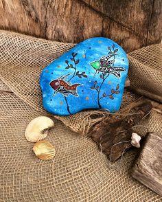 A new rock for my bookend collection - going blue #paintedrocks #rockart #bookend #doorstop #dotart #fish #underthesea #rusticart #beautifulstone #justblues #thestunnerboutique #australua #rusticdecoration #art_diaries #paintedstones