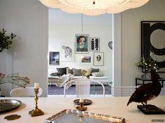 White Swedish Apartment With Wonderful Art - http://www.theikea.com/home-design-ideas/white-swedish-apartment-with-wonderful-art.html