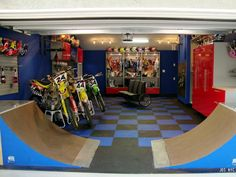 The ultimate sports themed man cave for the athletic guy. Bikes and a skating ramp, who can ask for more?