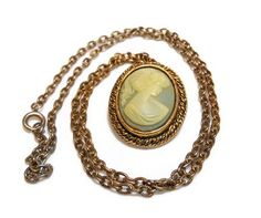 Vintage Peri cameo blue and white pendant and brooch. $15.00, via Etsy.