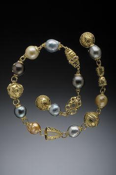 HUGHES BOSCA 18K GOLD JEWELRY | Necklace. Jumbo Baroque South Sea pearls with 18K Spacer beads featuring 37 colored Diamonds. Magnetic Ball Clasp.