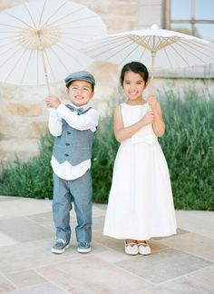 With an umbrella for the sun: http://www.stylemepretty.com/2015/06/19/the-most-adorable-flower-girls-ever/