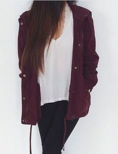 Maroon jacket, white shirt, and black leggings