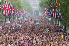 Crowds fill the Mall outside Buckingham Palace after the wedding ceremony of Prince William and Catherine Middleton, 29 April 2011.