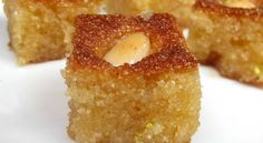 Hareeseh with almonds---a delicious arabic dessert. Other good Middle eastern desserts on this page! Arabic Dessert, Arabic Sweets, Arabic Food, Lebanese Desserts, Lebanese Recipes, Greek Sweets, Greek Desserts, Libyan Food, Puddings