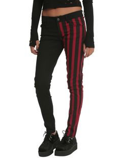 Split leg skinny jeans with a red & black stripe pattern leg and a solid black leg. Classic 5-pocket styling with signature Royal Bones grommets and back pocket design.