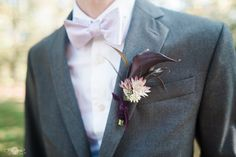 How cool and unique is this boutonniere for a purple wedding?