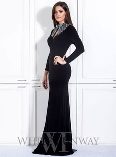 Nikita Dress. A stunning full length dress by Jadore. A chic long sleeve gown featuring an embellished high neckline.