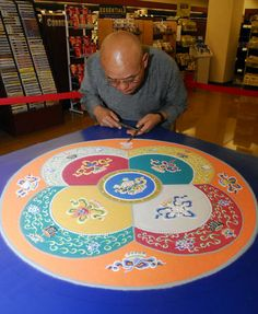 """Buddhist scholar returns to build mandala, evoking inner peace, at BookStore in Arizona- in this article he notes that he did not like taking the white sand through the airport used in his intricate sand mandalas """"Coming from the monastery, I had no clue about the drug thing."""" New York City airport officials detained him for hours"""