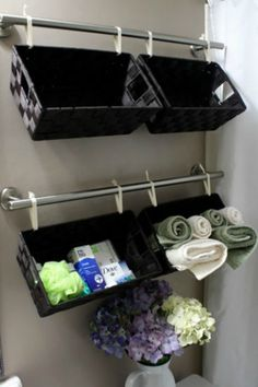 For a chic and stylish bathroom, organize your towels, soaps, and other bathroom necessities with hanging baskets. Get the tutorial here.    - Redbook.com