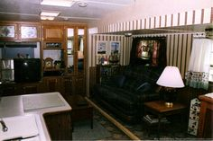 Our remodeled RV living room in a 5th wheel travel trailer. photo by Curtis at TheFunTimesGuide.com
