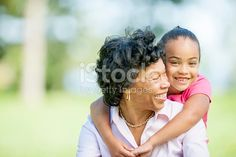 Grandma and Granddaughter spending quality time together in nature - outdoors at the park.