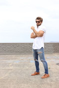 Shop this look on Lookastic:  http://lookastic.com/men/looks/brown-sunglasses-white-short-sleeve-shirt-blue-skinny-jeans-tobacco-derby-shoes/11009  — Brown Sunglasses  — White Short Sleeve Shirt  — Blue Ripped Skinny Jeans  — Tobacco Leather Derby Shoes