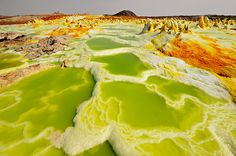 dallol volcano, ethiopia The chemicals coming out of Ethiopia's Dallol Volcano create a kaleidoscope of colors and surreal, twisted mineral deposits. But despite its beauty, the toxic fumes ensure that it might be one of the last places you ever see Beautiful World, Beautiful Places, Amazing Places, Science And Nature, Natural Wonders, Natural World, Planet Earth, Terra, Amazing Nature