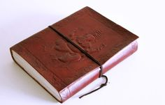 hand made recycled paper journal or sketch book with beautiful imprint of Hindu Lord Ganesh on the leather cover.
