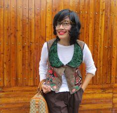 I really love my  cat eye glasses from Miu Miu Miu (Miu MU07MV ) ,it is from  miu miu summer 2014 collection I also wear Batik Amarillis crescent vest,zara top and gucci boston bag