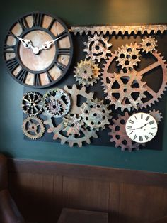 Our wedding backdrop at Starbucks. Jim & I made it from styrofoam gears that we used for a stage set. We added more gears and clocks arranged them on black coroplast and hung the whole arrangement over an existing picture.