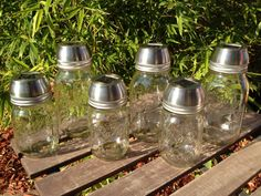 Solar light lids for mason jars. Cute for DIY yard light!....I'm going to put colored stones in the jar!