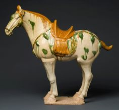 Sancai glazed pottery horse, Tang dynasty (618–906). From the Collection of Jane and Leopold Swergold.