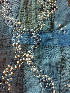 A scattering of stars - Backbone of the night. Textile piece involving Japanese Boro techniques of layering fabrics and stitching together. Vintage fabrics dyed indigo.