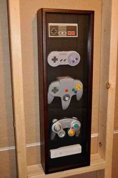 Classic, Super, GameCube, Wii Nintendo controller wall display case - this would be awesome for Ricky's game room Sala Nerd, Deco Gamer, Wall Display Case, Geek Home Decor, Geek Room, Nintendo Controller, Nerd Cave, Video Game Rooms, Video Games