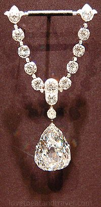 "The Star of South Africa. The first important large white diamond to come from South Africa, it is credited for a drastic economic turn-around for the region. Found in 1869, it weighed 83.5 carats in rough crystal form and was cut into a 47.69-carat old style pear-cut diamond.  The stone was later called the ""Dudley Diamond."""