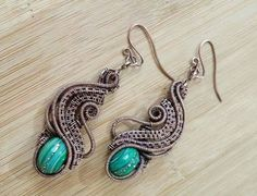 Check out this item in my Etsy shop https://www.etsy.com/ca/listing/251206401/wire-wrapped-earrings-deep-blue-green