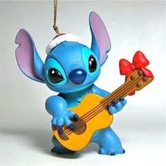 "Do you think Stitch actually knows how to play Christmas carols on the ukelele? Or is he just faking it? STITCH PLAYING UKELELE ORNAMENT (by Grolier) (from Walt Disney's ""Lilo and Stitch"")"