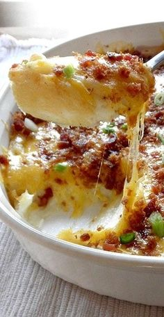 Twice-Baked Potato Casserole with Cream Cheese, Sour Cream, Bacon, & Cheddar Cheese _ I'm making up the potato skins recipe based on what I remember eating at the Black Angus waaaaay back when I was a kid. I just remember them being crisp, greasy, cheesy, & bacony. Mmmm... I might be out of control!