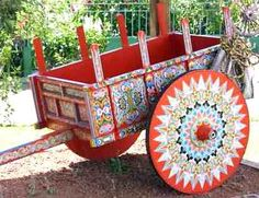 Sarchi (day 8): As late as the 1960's, the oxcart was the primary mode of transport through the mountains. Around 1910, ticos started decorating their cart wheels. Each district in Costa Rica had their own unique design and locals could tell where each cart came from.