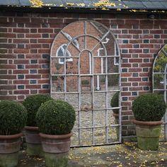 Декор сада. Зеркало в саду