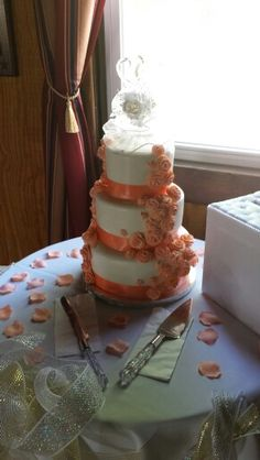 Peach accented wedding cake