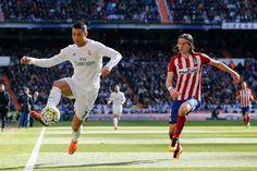 Cristiano Ronaldo of Real Madrid controls the ball beside Filipe Luis of Club Atlético de Madrid during the La Liga match between Real Madrid CF and Club Atlético de Madrid at Estadio Santiago Bernabéu on February 27, 2016 in Madrid, Spain.