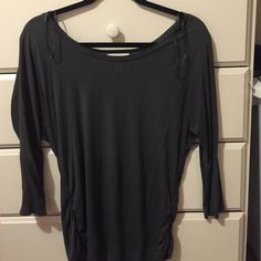 Comfortable top Three-quarter length sleeve can be just up or dress down or even worn with leggings and boots in the winter it is a gray color has synching  on the side of the hips has slight stain in the front  Worn once Tops Tees - Long Sleeve
