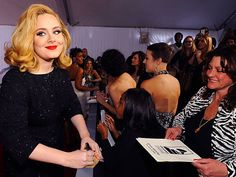 Before claiming multiple Grammy awards, Adele takes time out to sign off on a fan's Post-It.