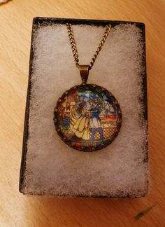 Disney characters and Princesses stained glass/mosaic cameo Cufflinks, necklace or Brooch (19 options) Beauty and the Beast, Ariel. £8.00, via Etsy.