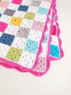 This is a listing for a PDF crochet pattern for a baby blanket that is 60cm wide and 85cm long. In this pattern youll find the following information: - the amount of yarn you need to make this baby blanket; - a photo tutorial on how to make the squares; - a photo tutorial on how
