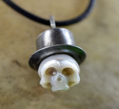 Carved Pearl Skull Wearing Sterling Silver Top Hat on Leather Cord... Look at that top hat