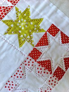 Look at the lovely contrasting hand quilting here! Great fabric choices to boot! Detail of table runner by Susan Snooks of Patchwork 'n' Play.