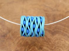 I just like this bead....it is really just too cool. I think I might have to try it out.