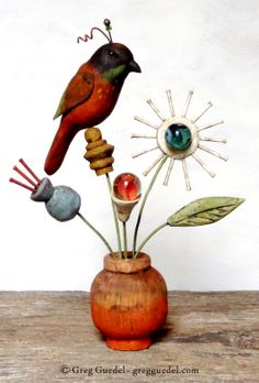 Folk art flowers and bird sculpture by Greg Guedel. ~ Carved wood, nails and vintage marbles.